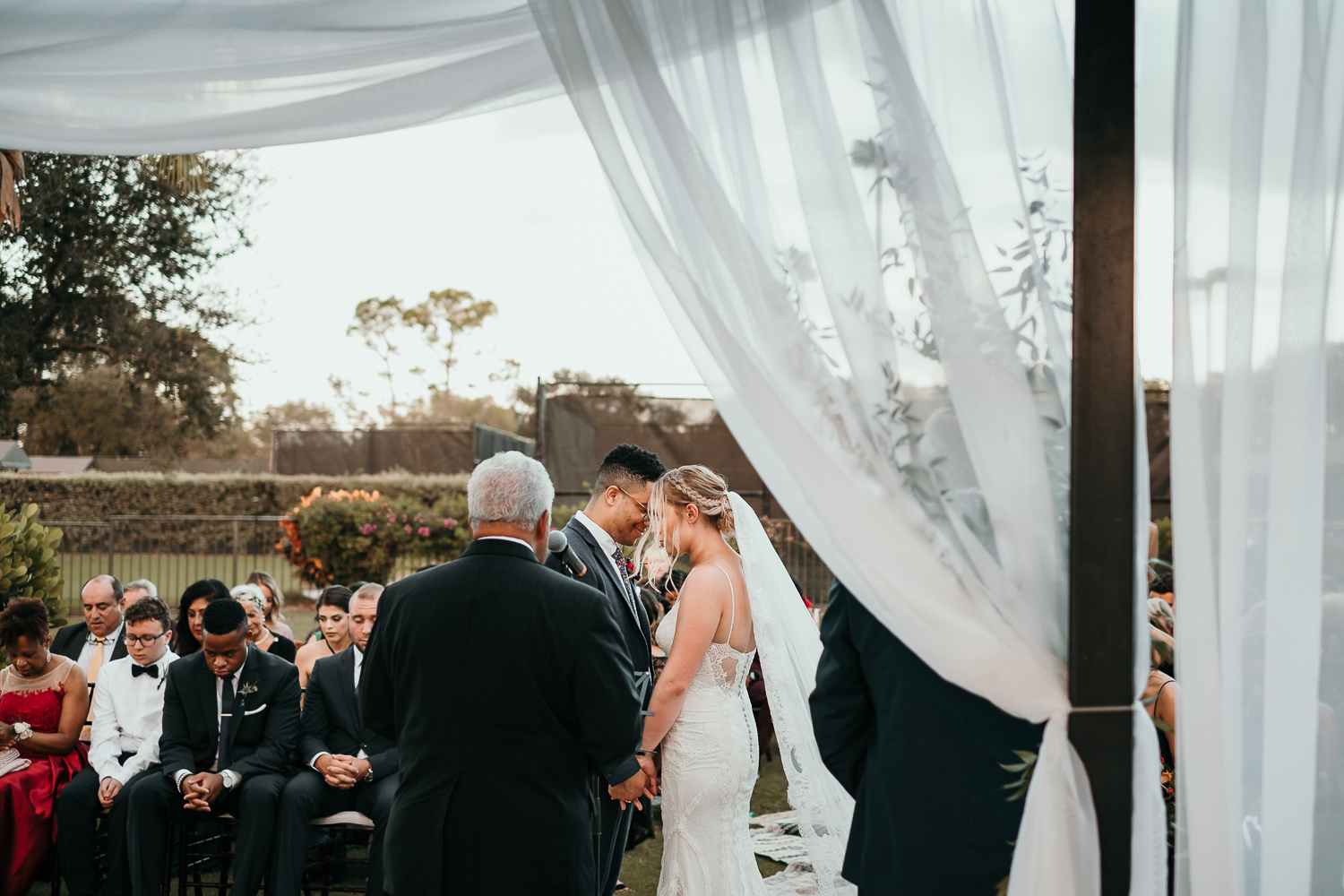 angle from officiants view of bride and groom praying