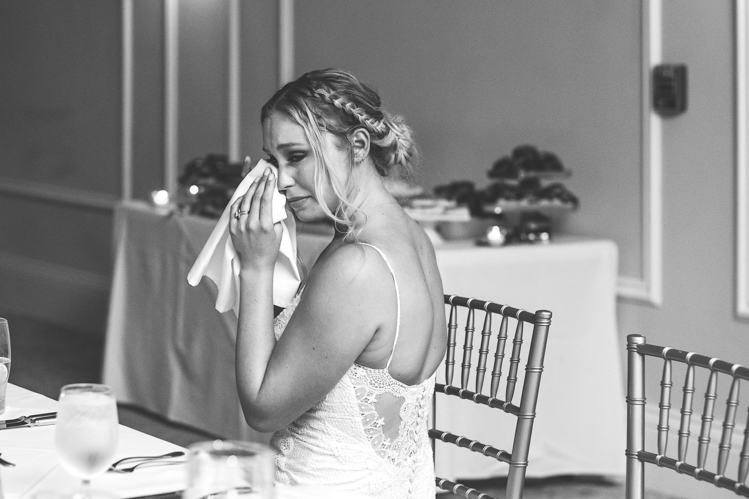 bride crying during first dance black and white