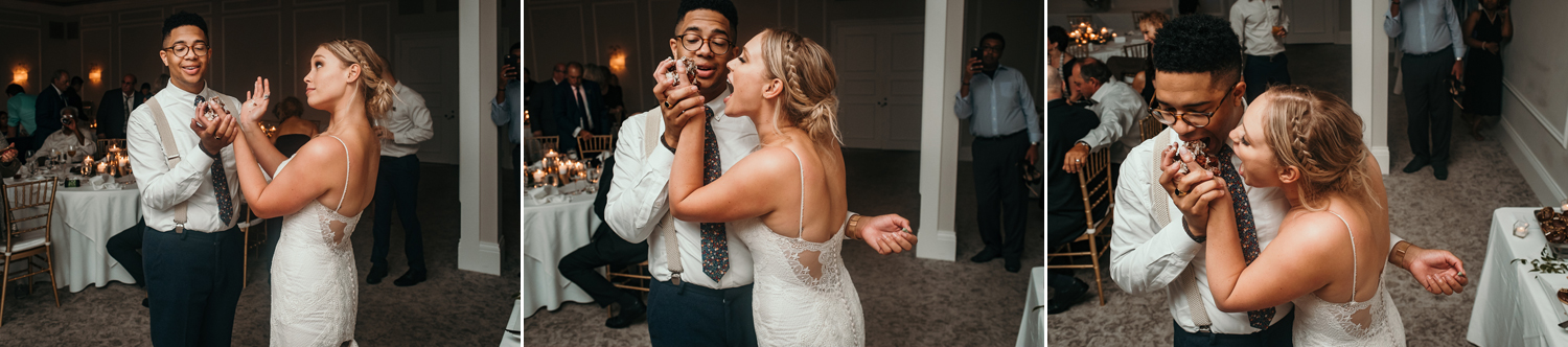 newlyweds trying to share cake with hands