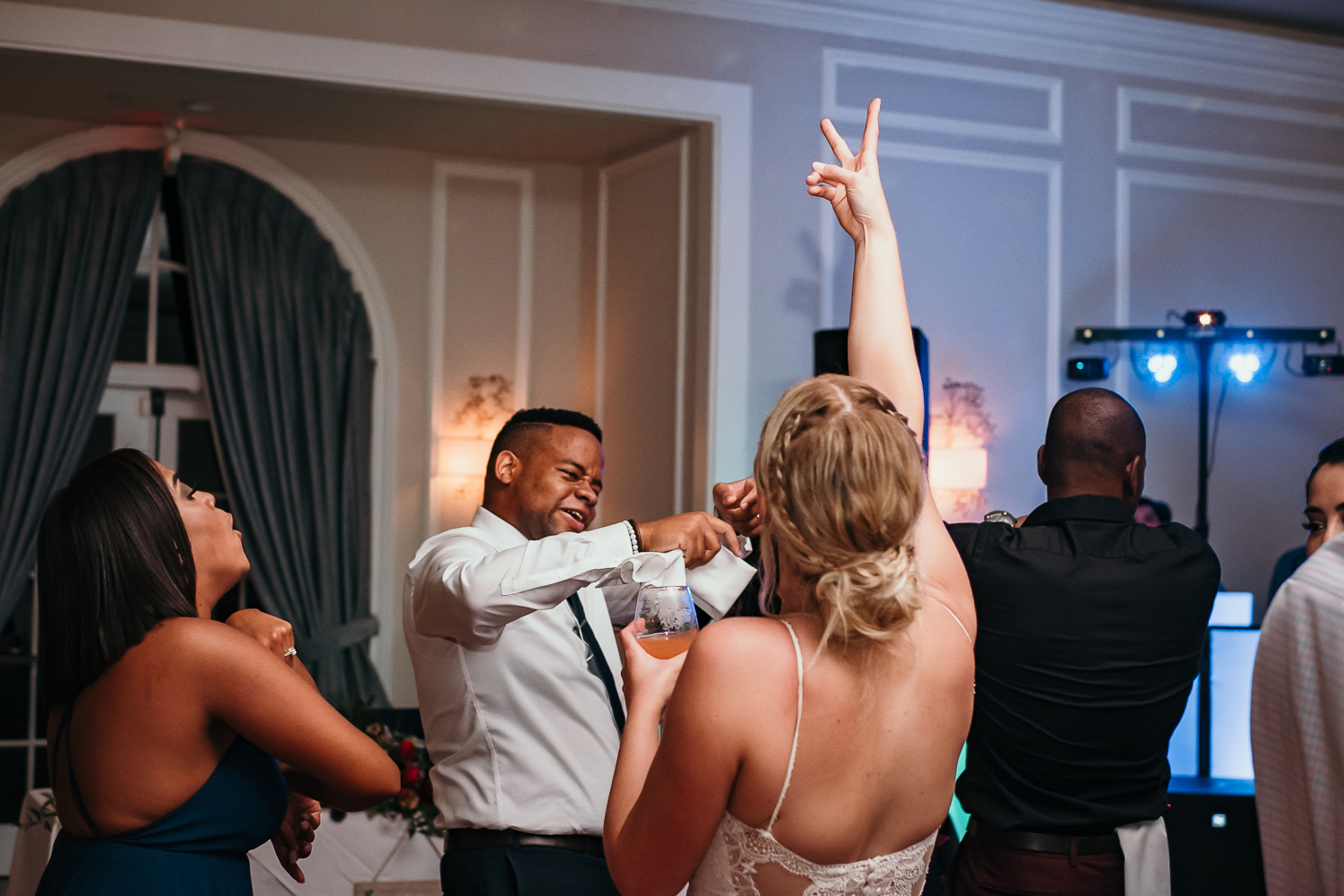 bride throwing peace sign