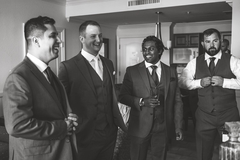 groomsmen laughing watching football