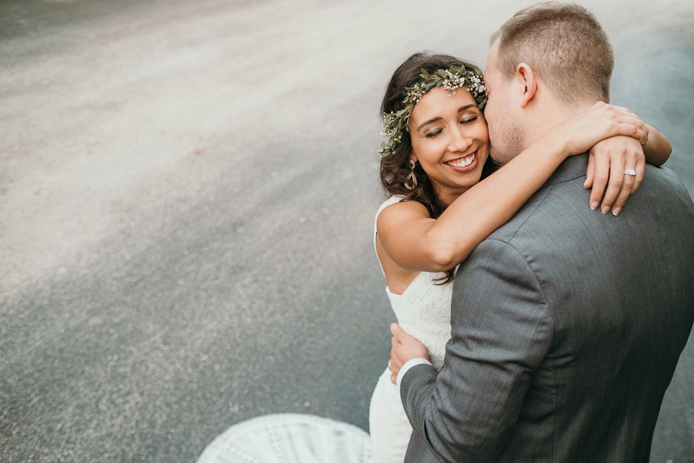 bride and groom kissing cheek close up