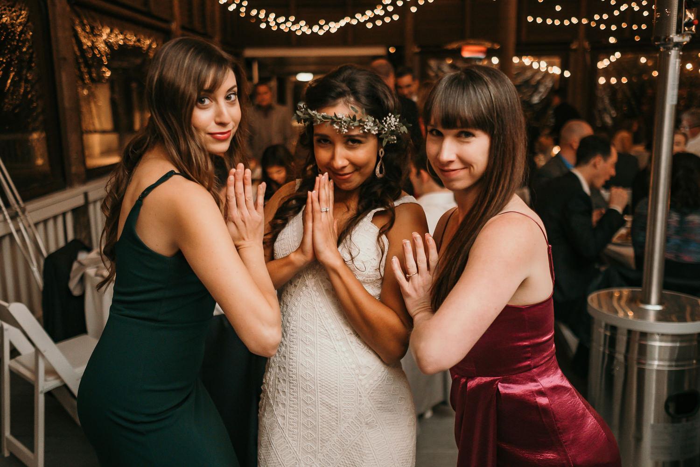 bride and friends prayer hands