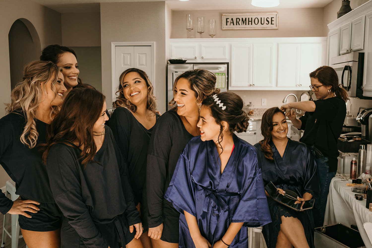 bridal party in robes bride on the side