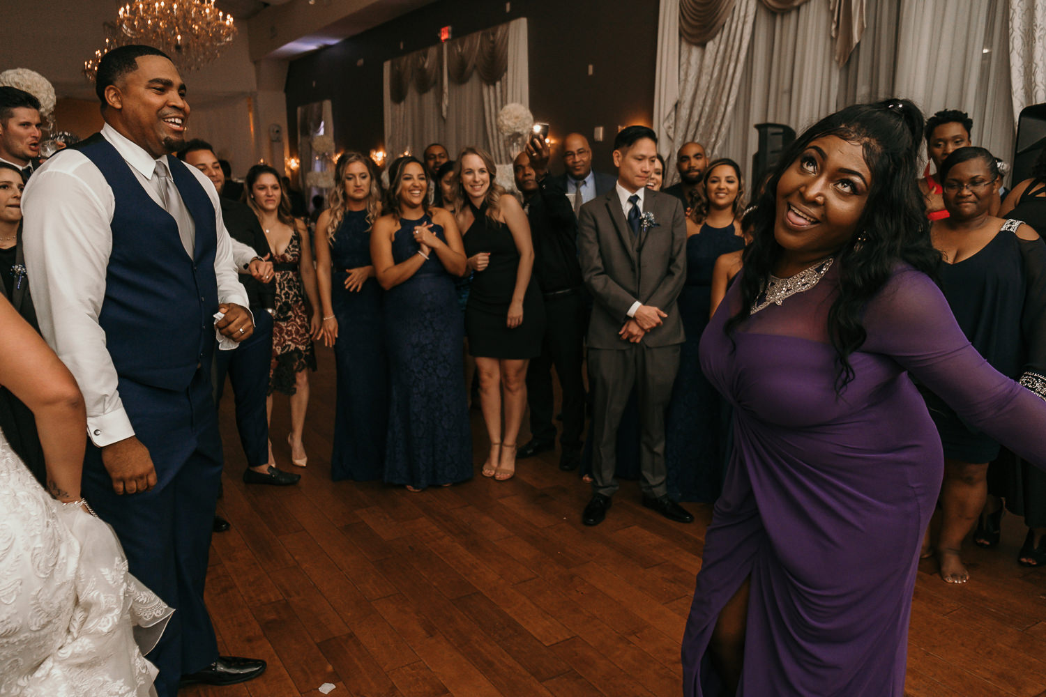 cousin of groom purple dress dancing tongue out