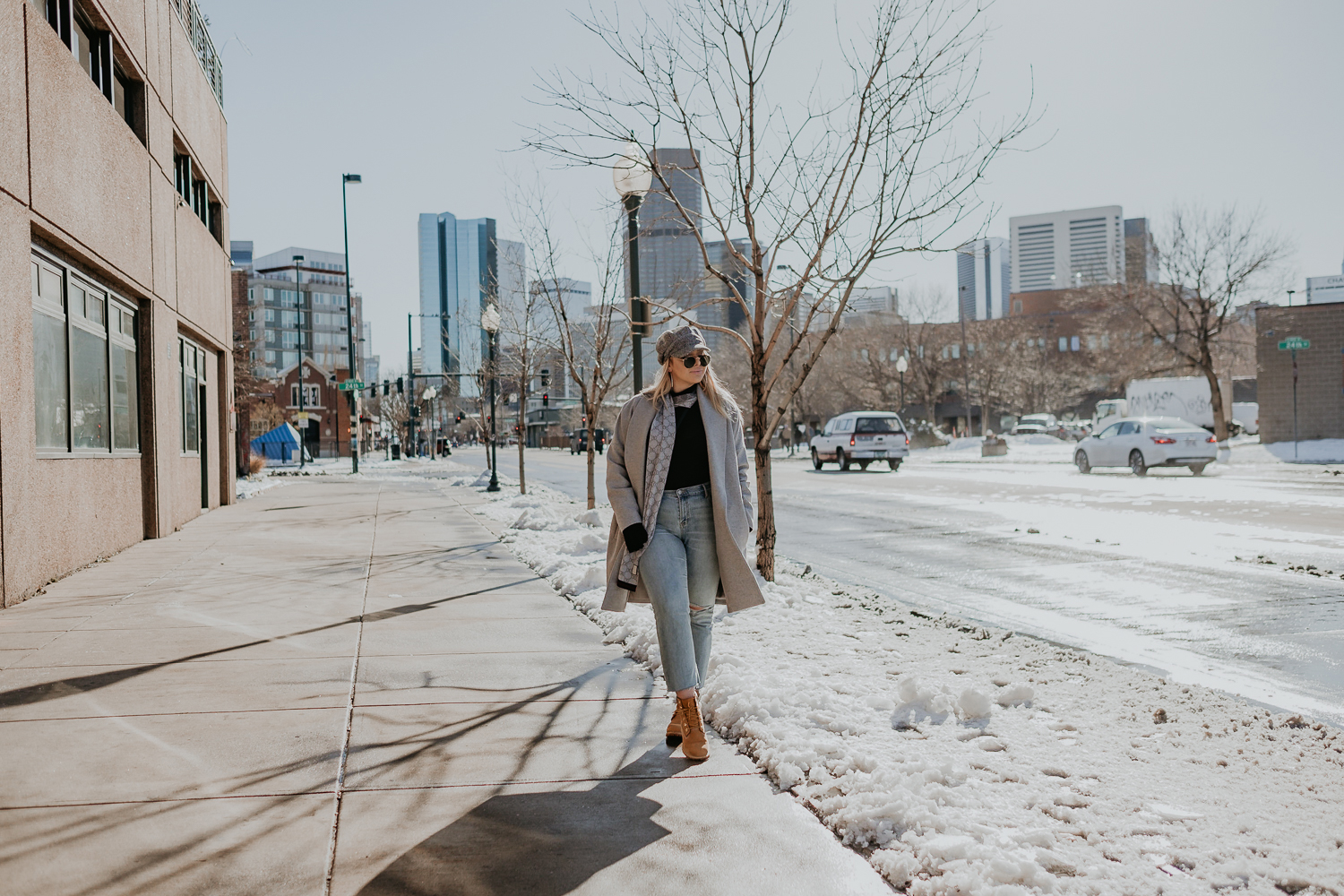 wide shot of Tessa on Denver street wearing timberlands and Gucci scarf