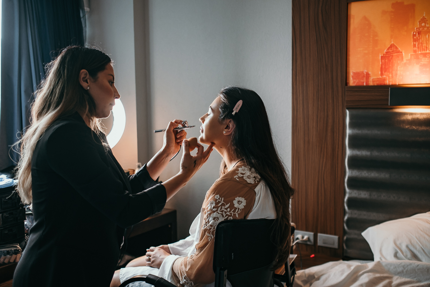 side angle make up artist with bride