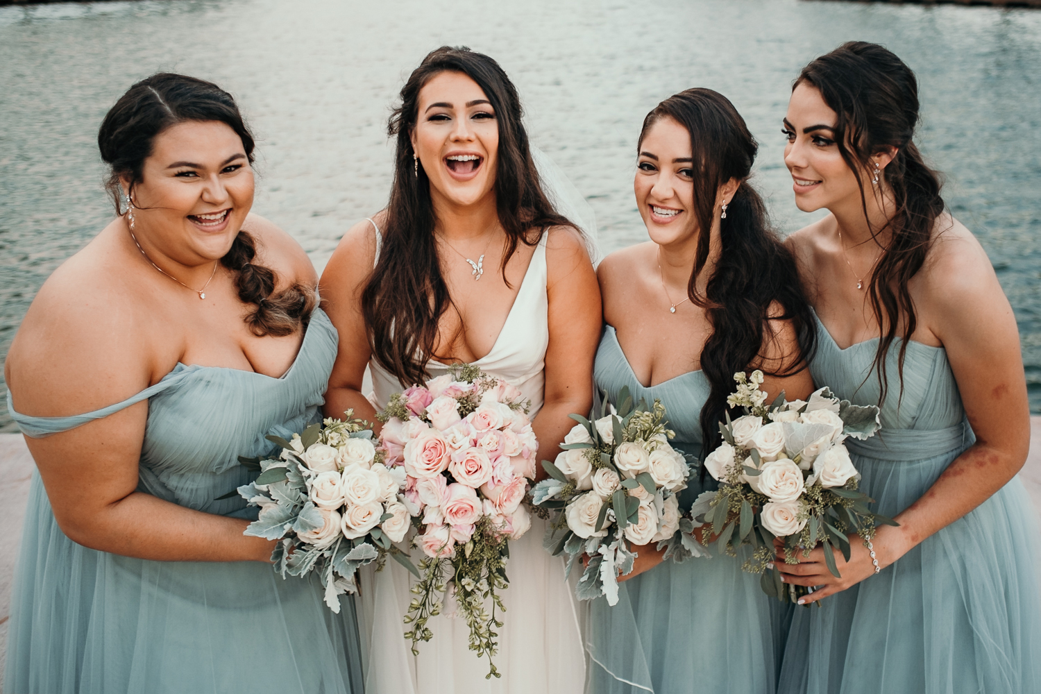 bridesmaids with lake in background