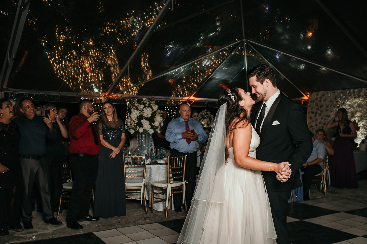 bride and groom being cute during first dance