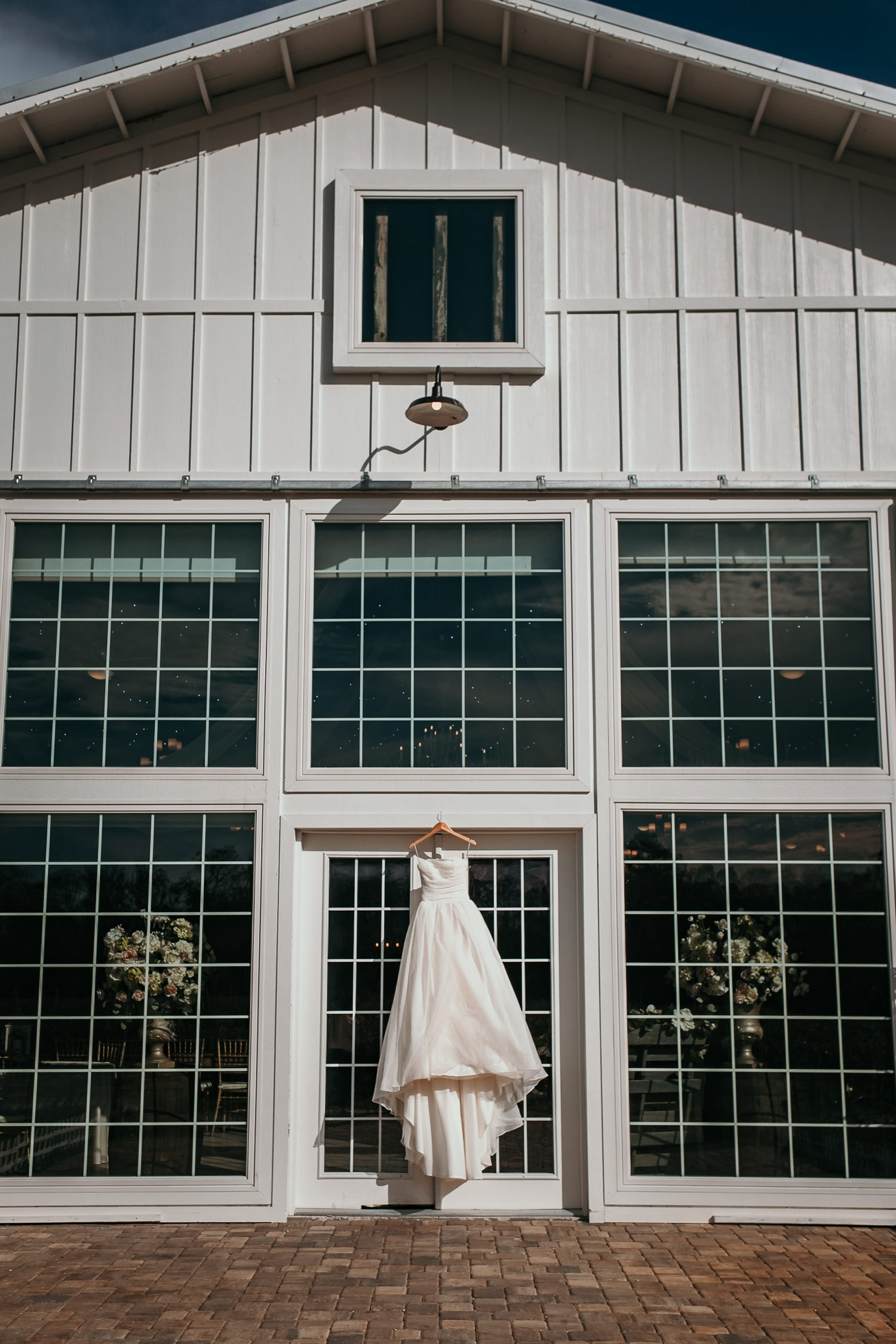 dress hanging over glass door at ever after barn