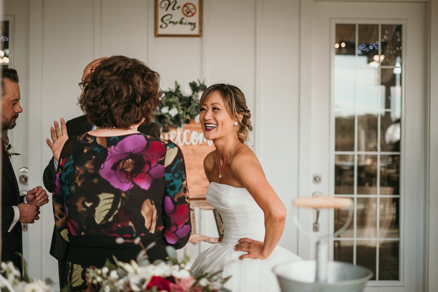 bride smiling with wedding guest