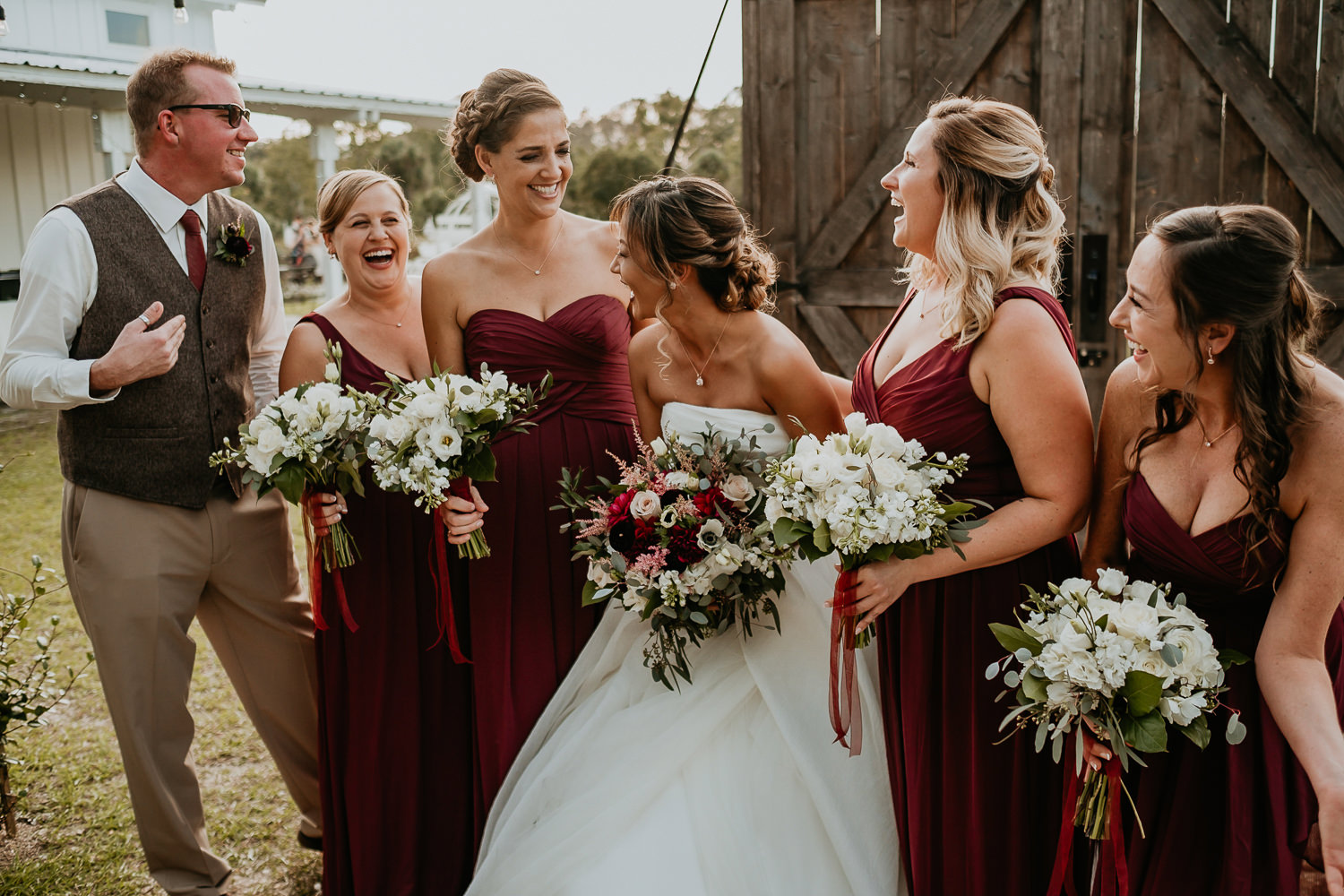 close up of bride and bridal party laughing