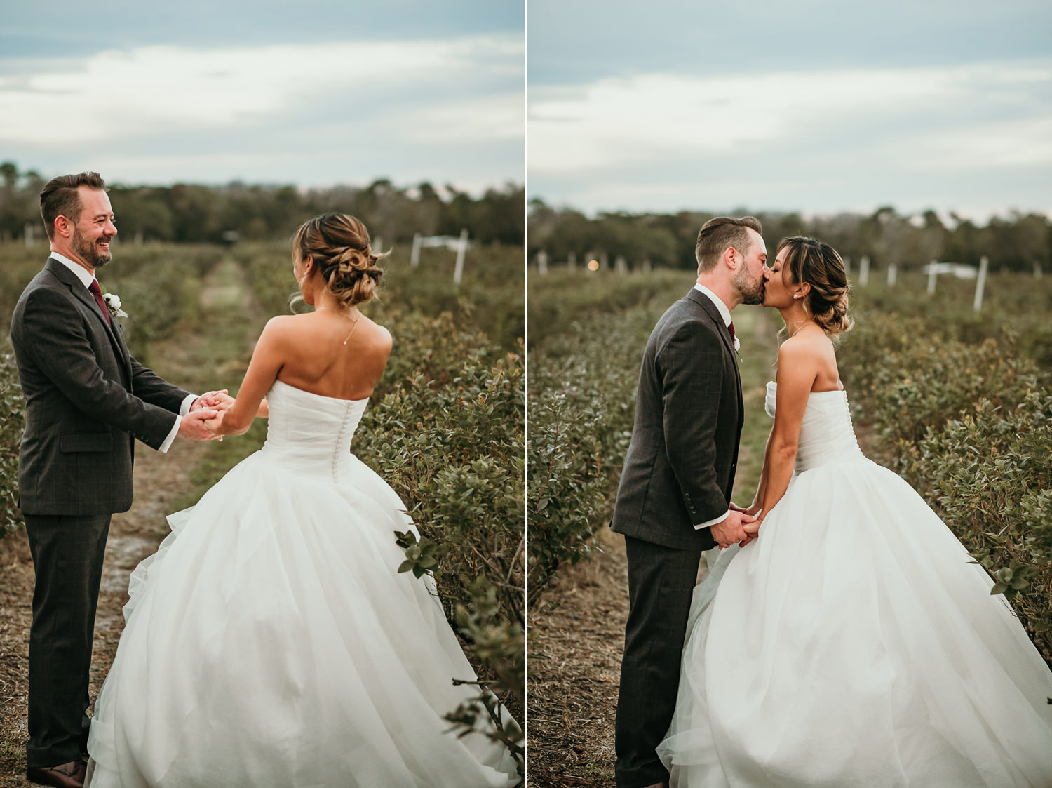 close up newlyweds kissing in middle of field