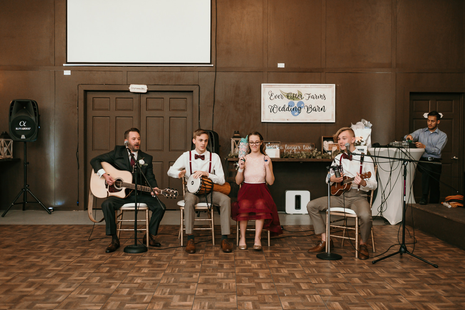 groom and his kids performing a song to bride