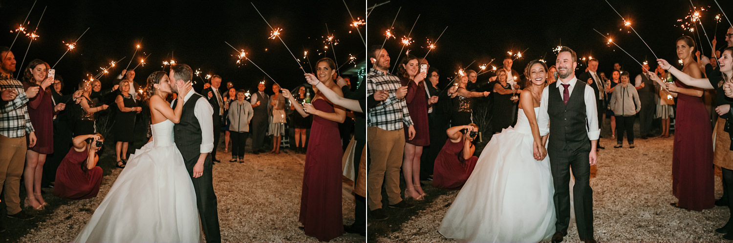 newlyweds kissing at end of sparkler exit