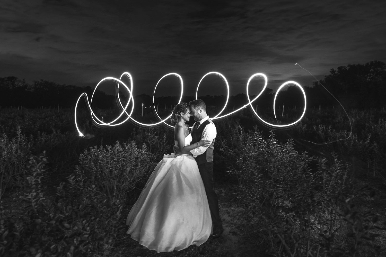light trail circles with bride and groom foreheads touching