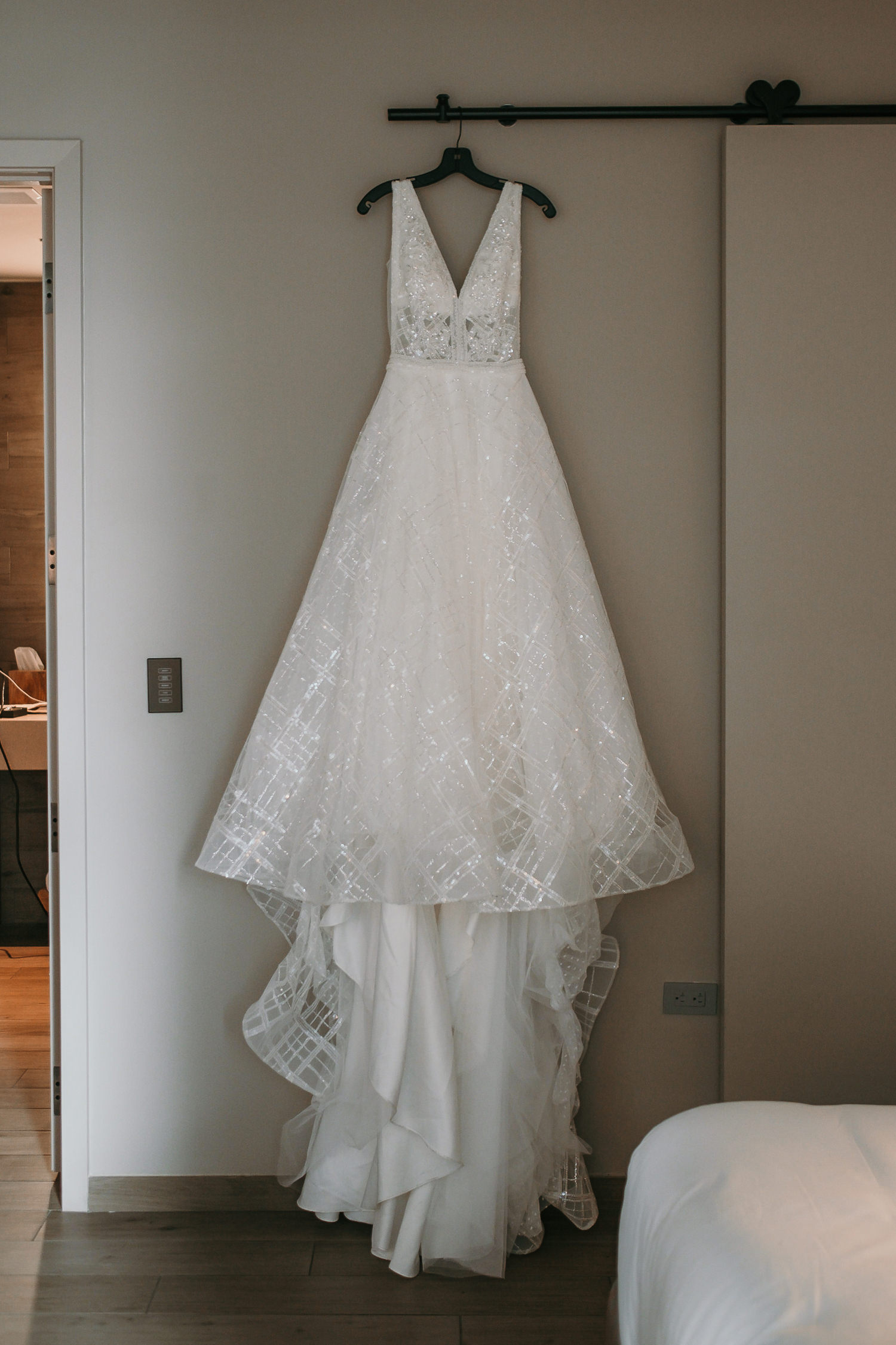 brides dress hanging inside east hotel