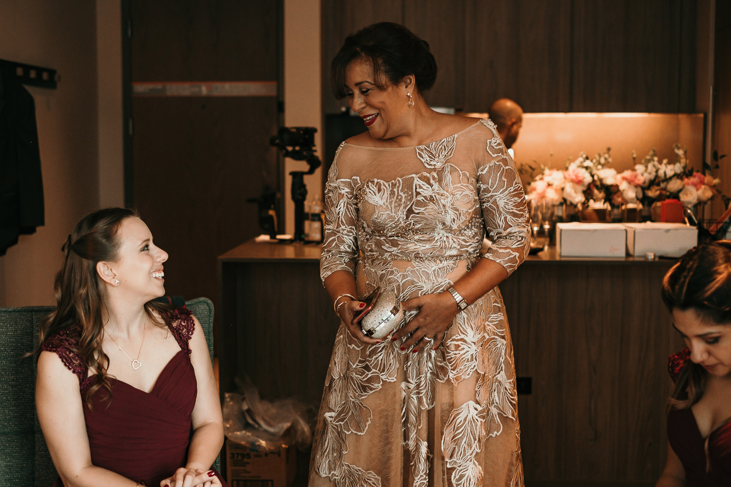 mother of the bride laughing with bridesmaid