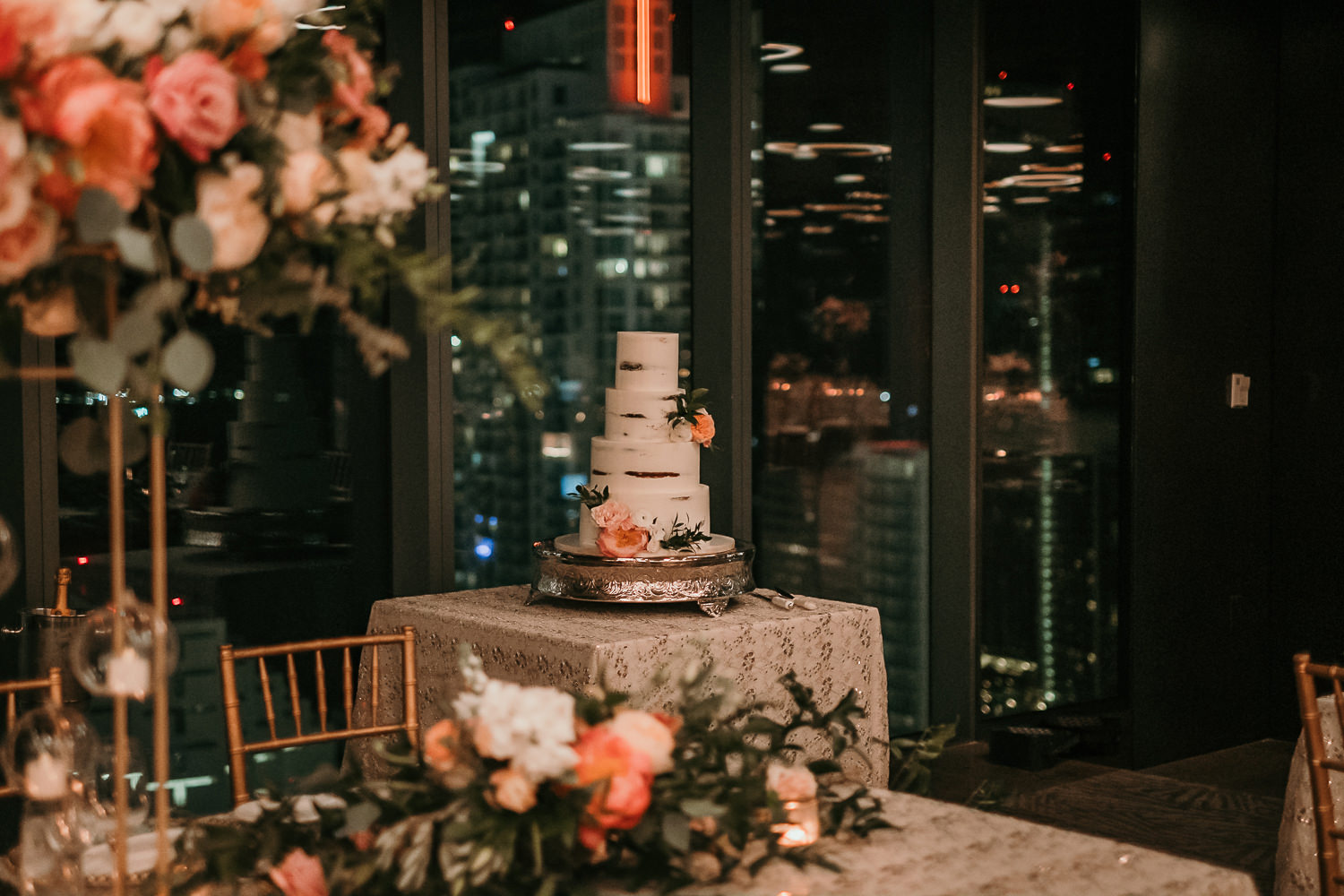 far away shot of cake with nighttime view in background