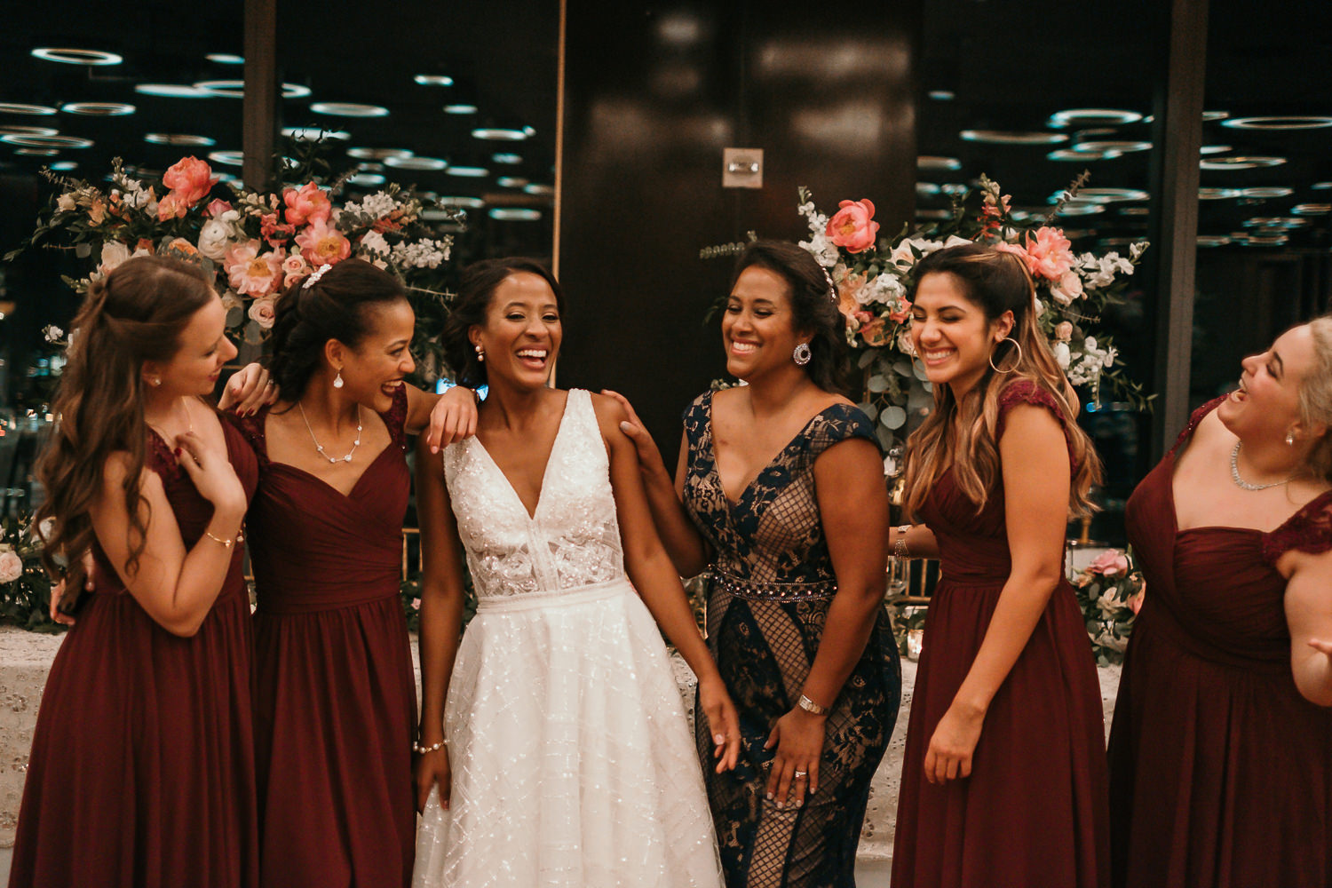 bridesmaids laughing side by side