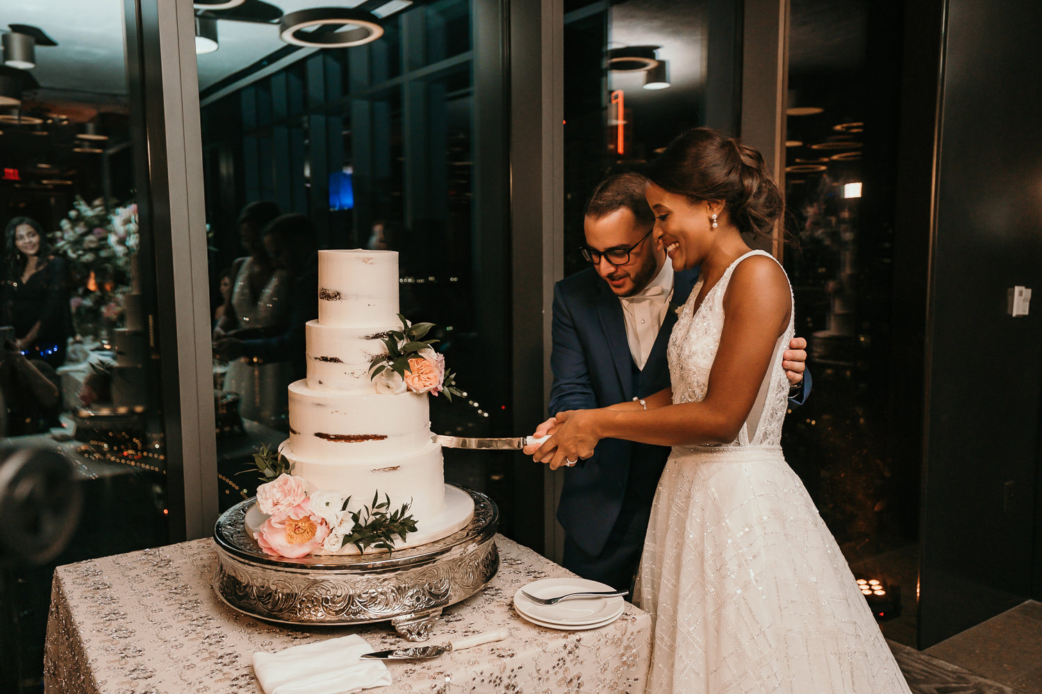 newlyweds cutting their cake