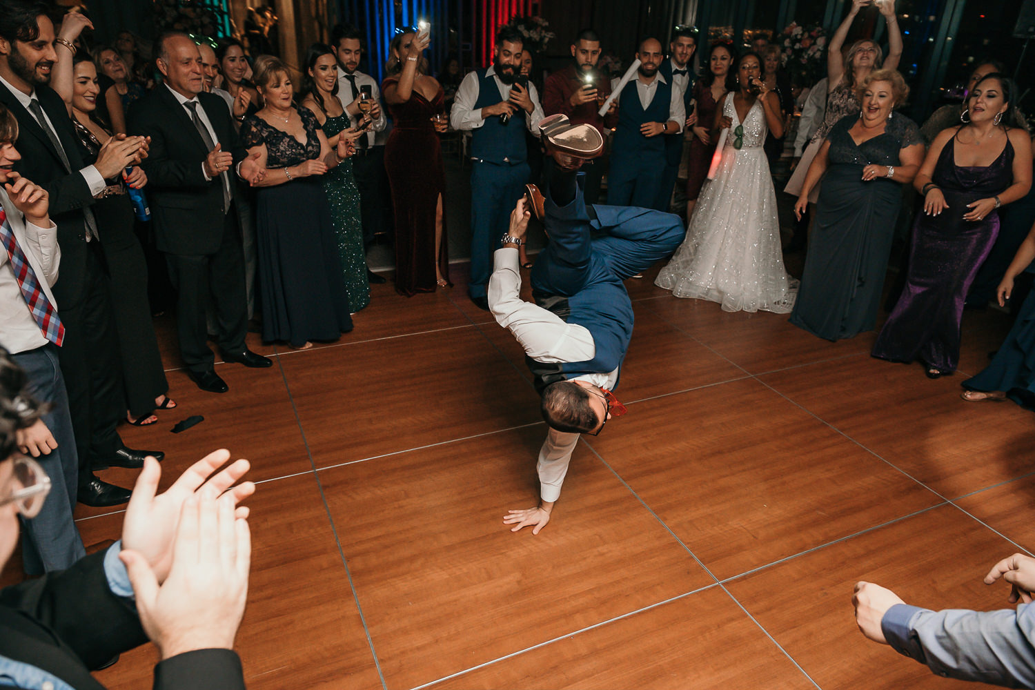 groom break dancing guests in a circle
