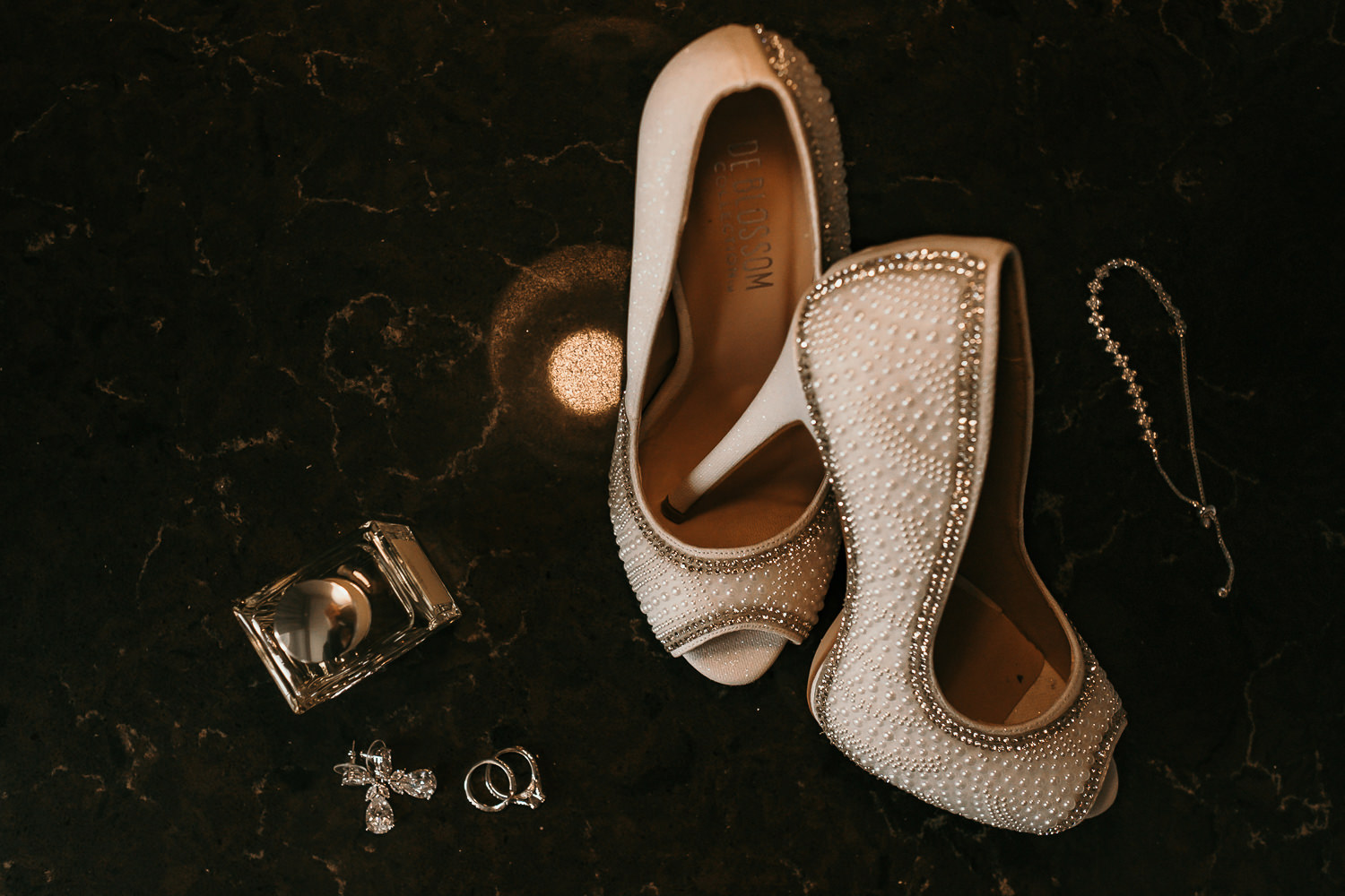 overhead shots of brides shoes and details