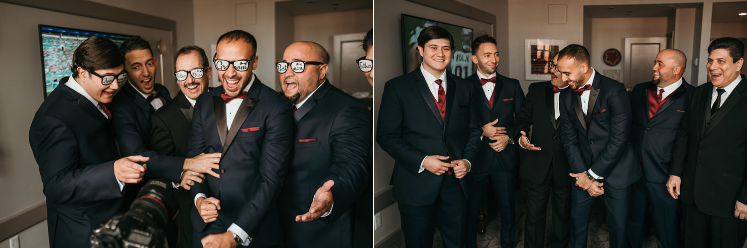 groom with groomsmen laughing at video camera