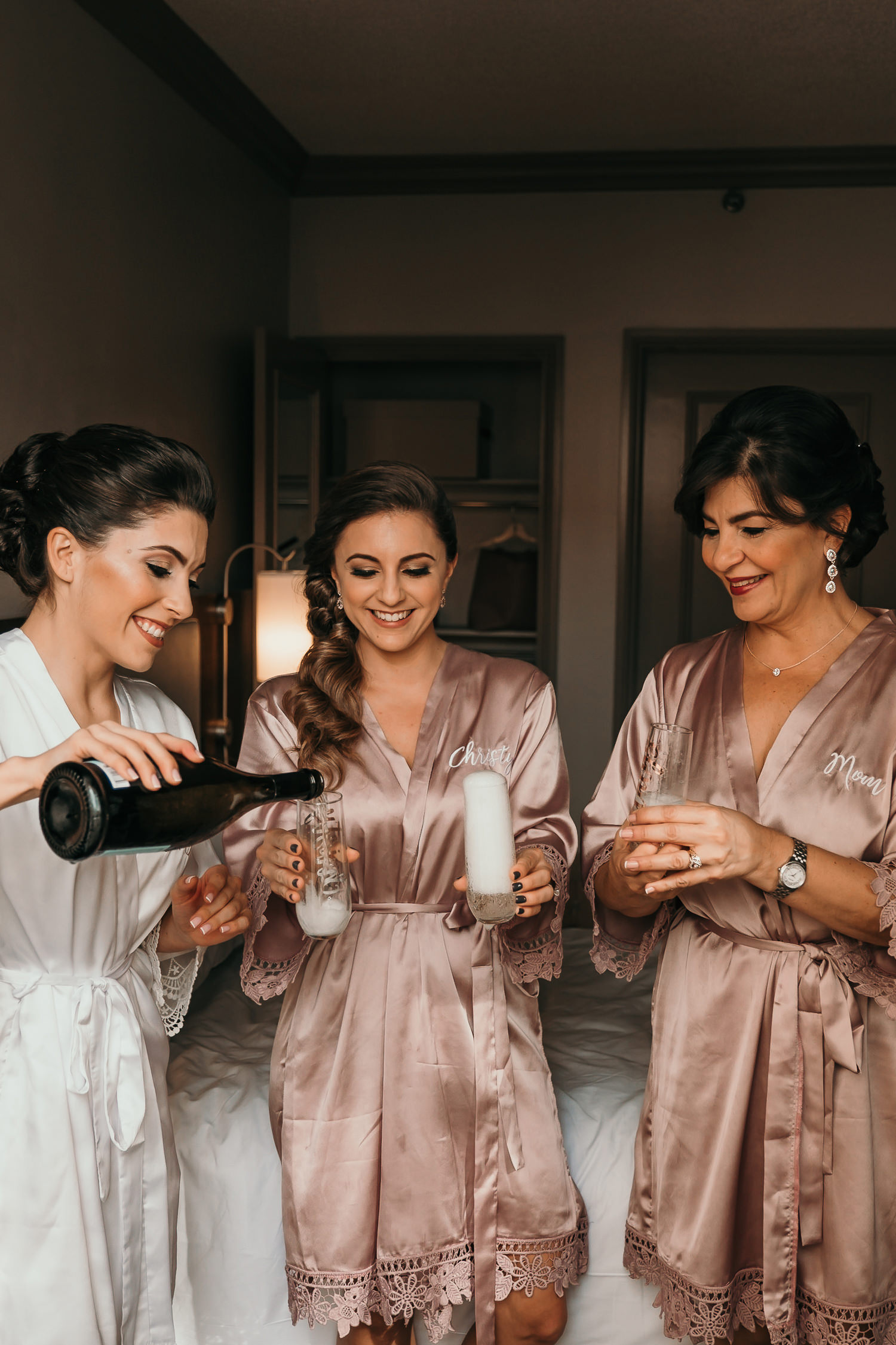 bride pouring her maid of honor and mother champagne
