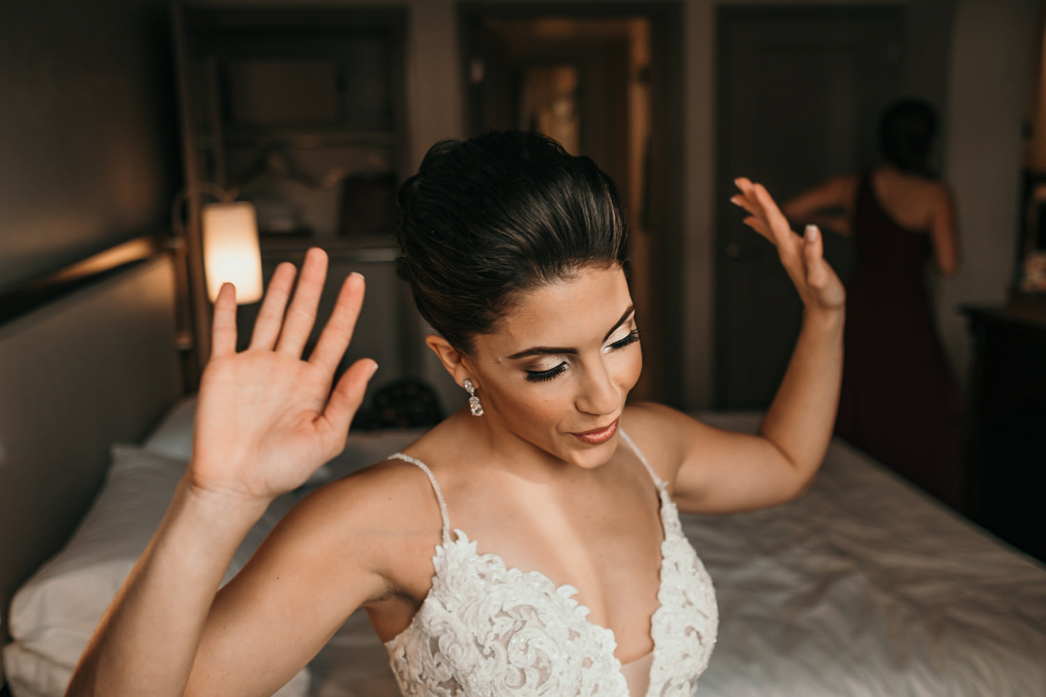bride celebrating with her hands up
