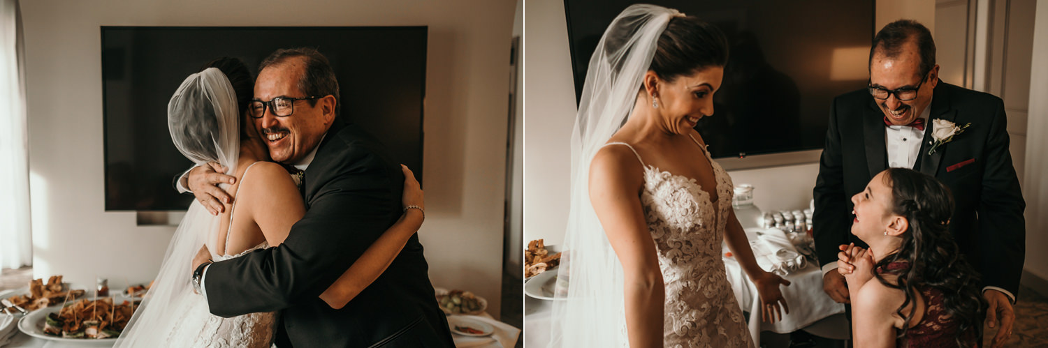father hugging bride laughing