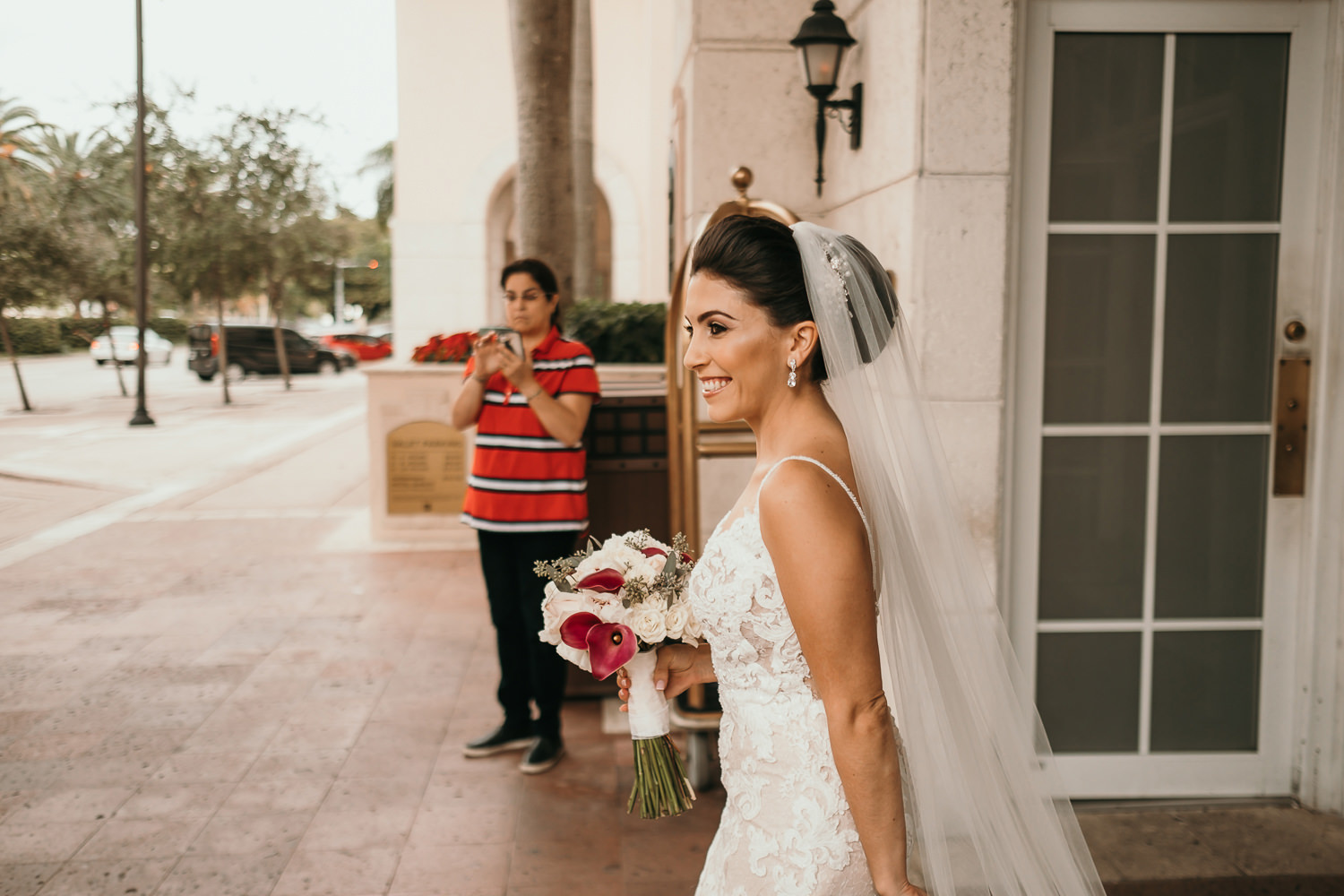 bride cheesing as she exits the hotel lobby