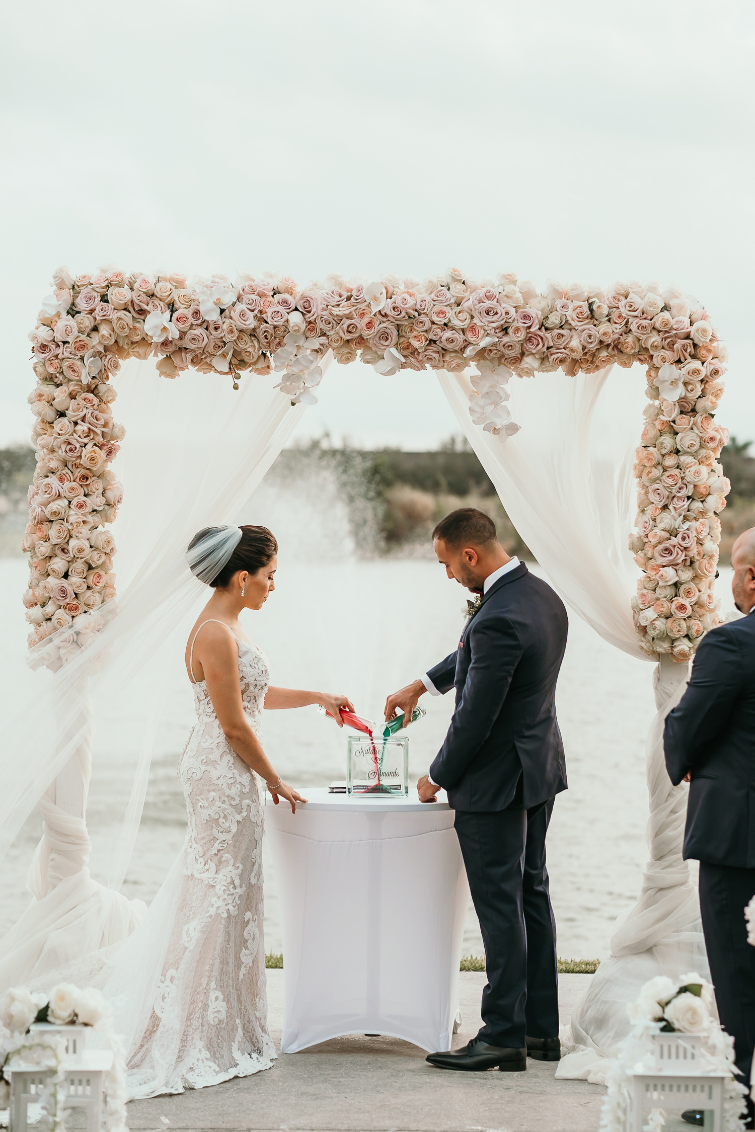 bride and groom pouring sand during ceremony