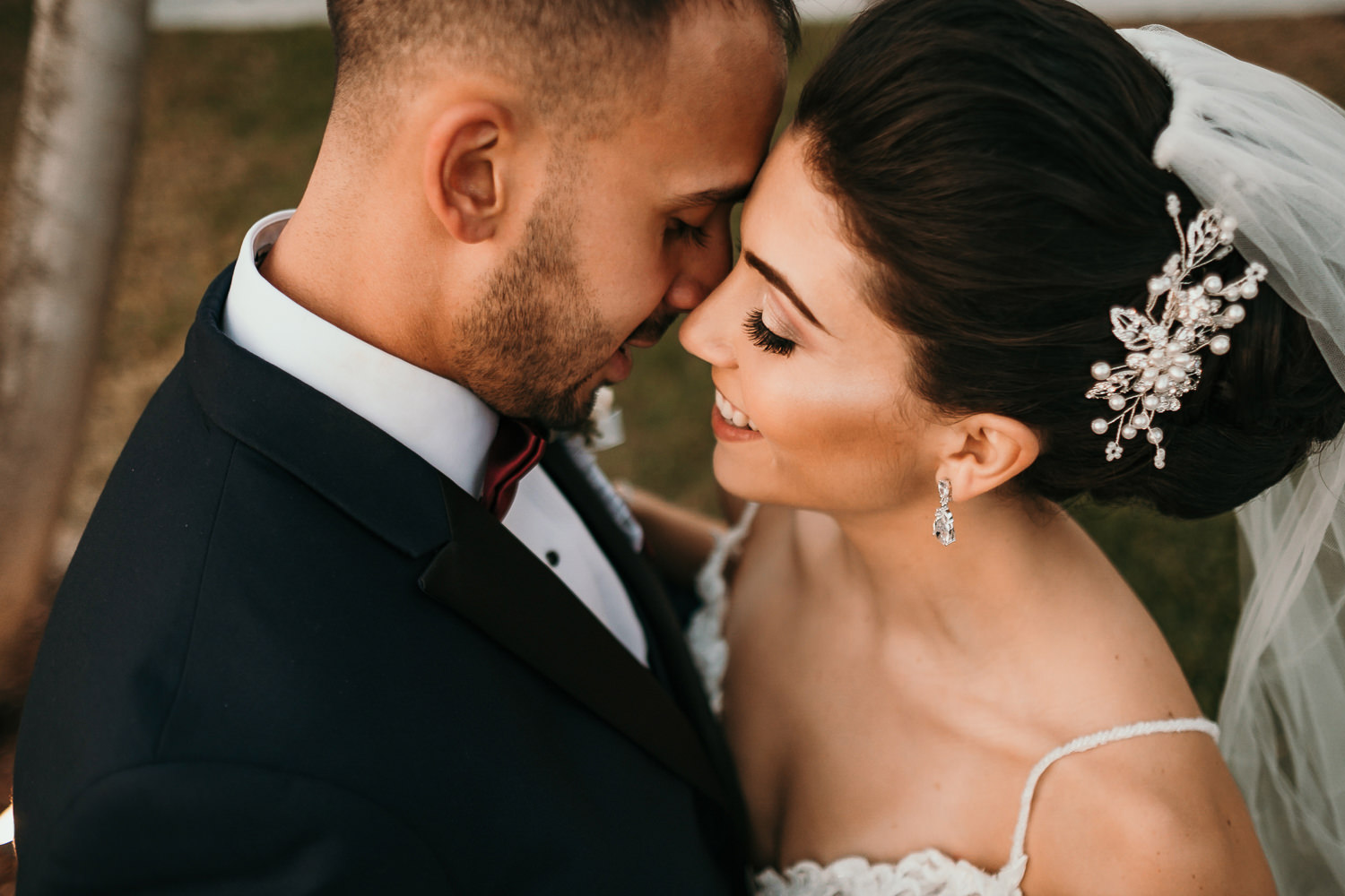 close up of intimate newlywed picture foreheads touching
