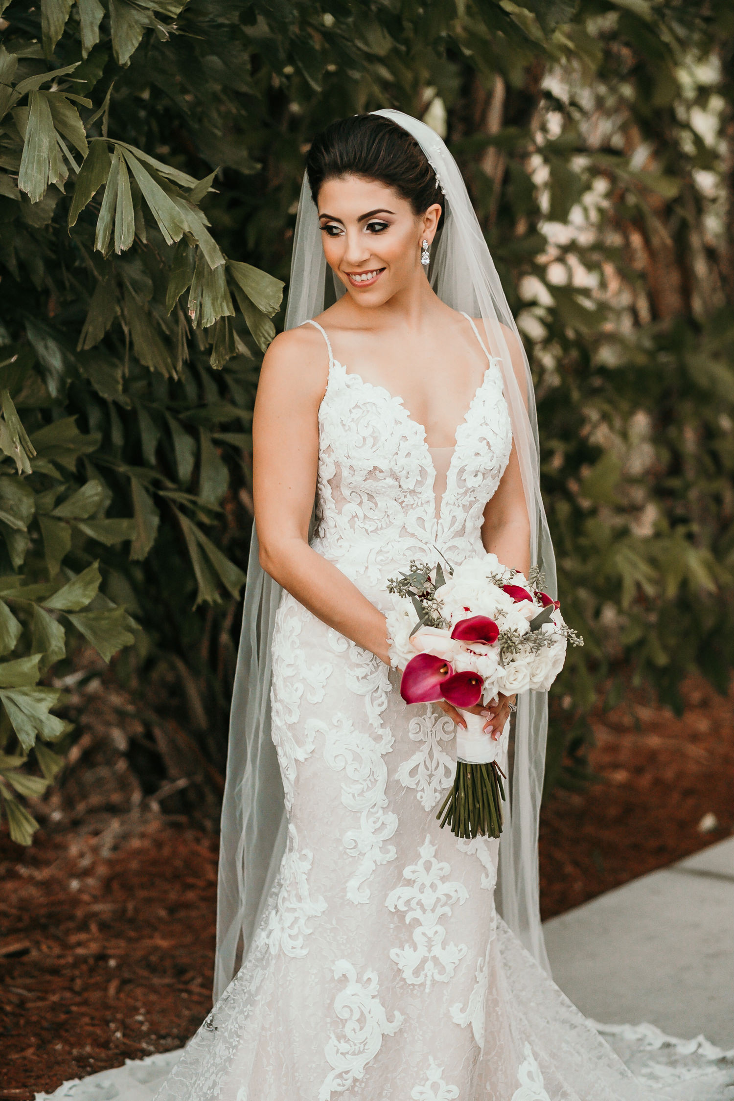 bride posing with her flowers