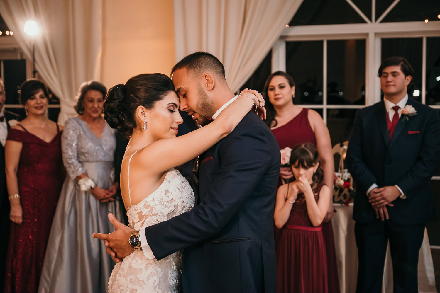 bride and groom foreheads touching during first dance