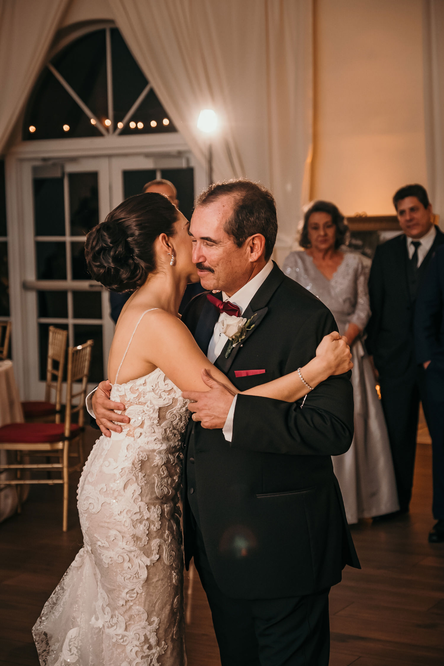 father daughter dance kissing cheeks