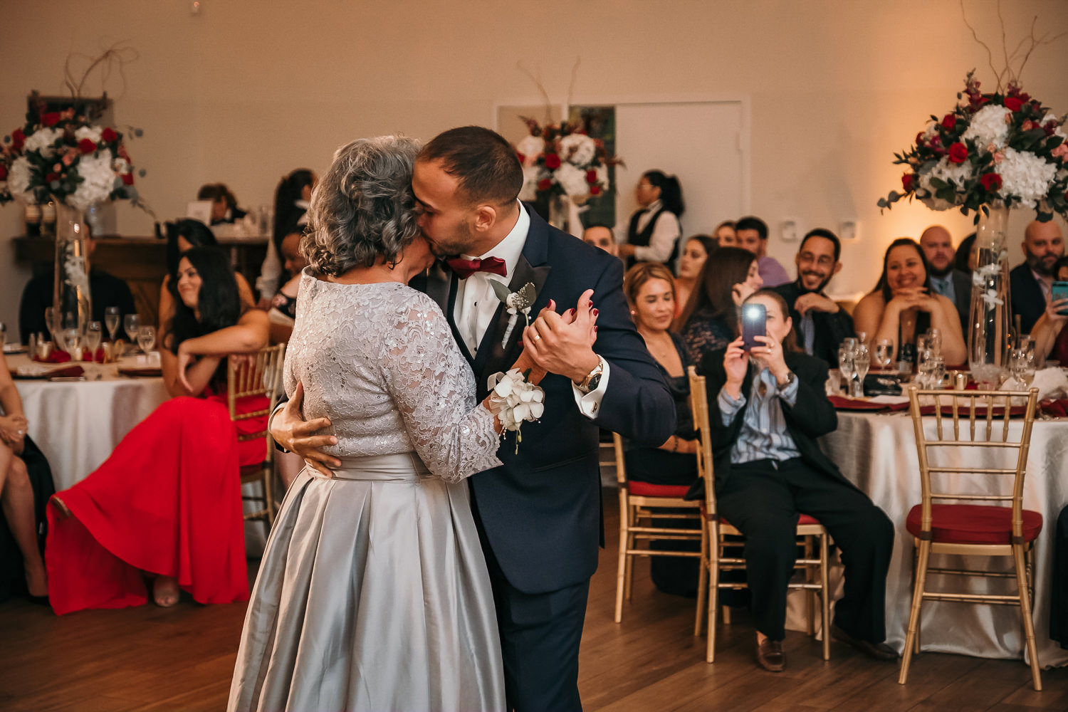 son mother dance groom kissing mothers cheek