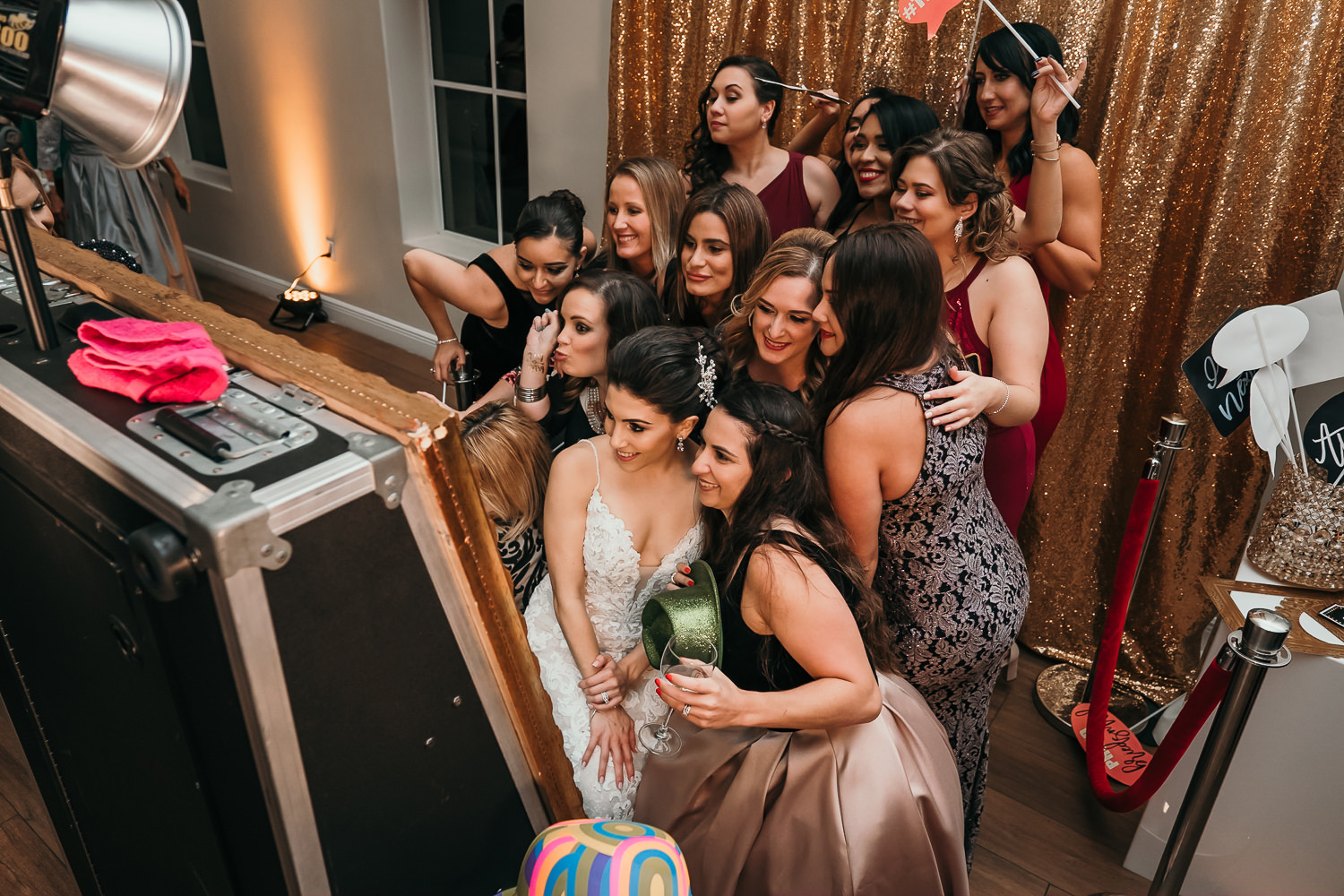 overhead shot of bride and her friends at Photo Booth