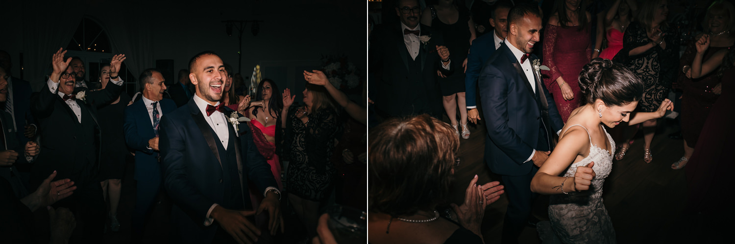 guests dancing groom in the middle