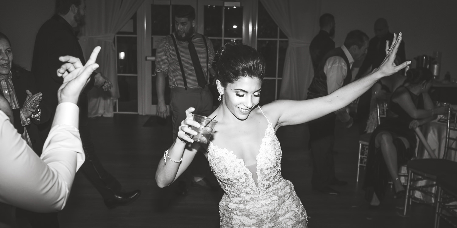 black and white bride dancing like no one is watching