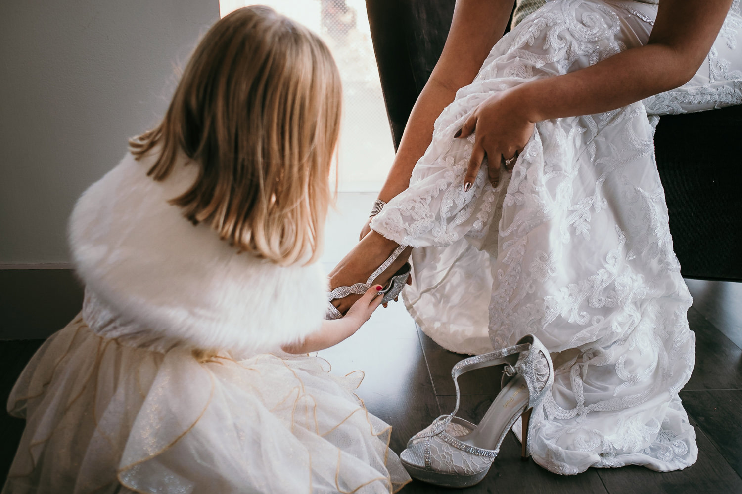 daughter in law helping bride with her shoes