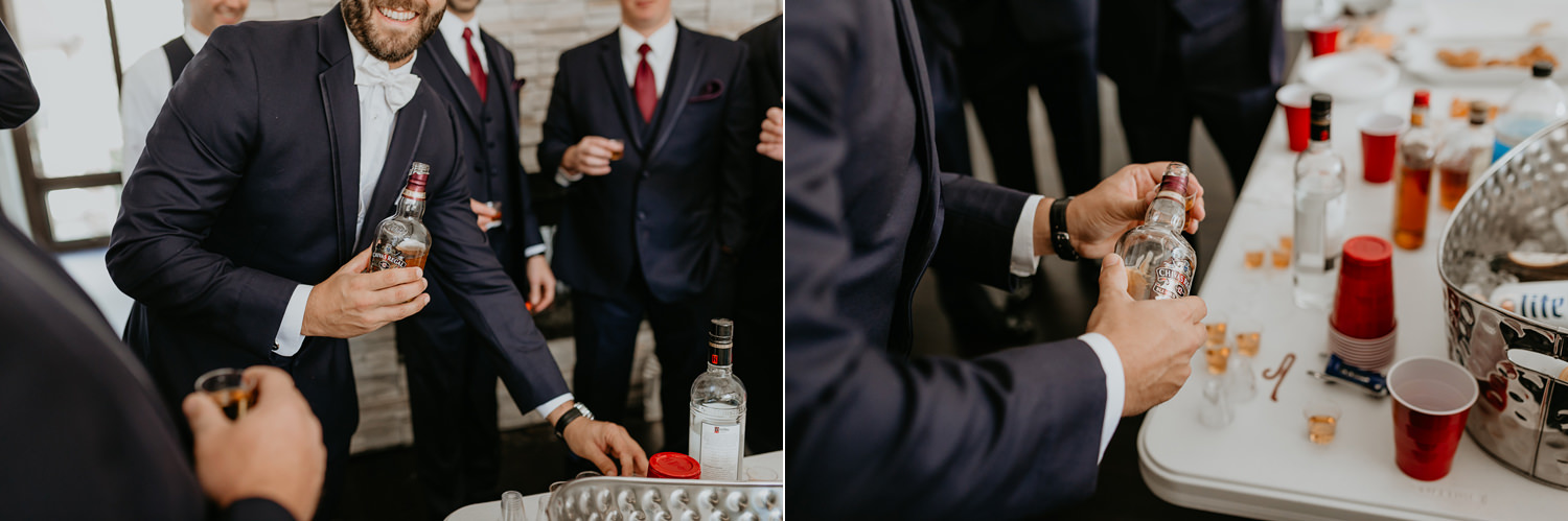groom preparing drinks for groomsmen