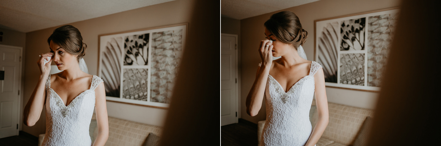bride with tissue wiping her tears