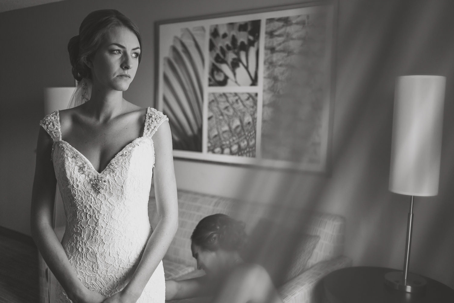 black and white bride looking out the window her eyes are watery