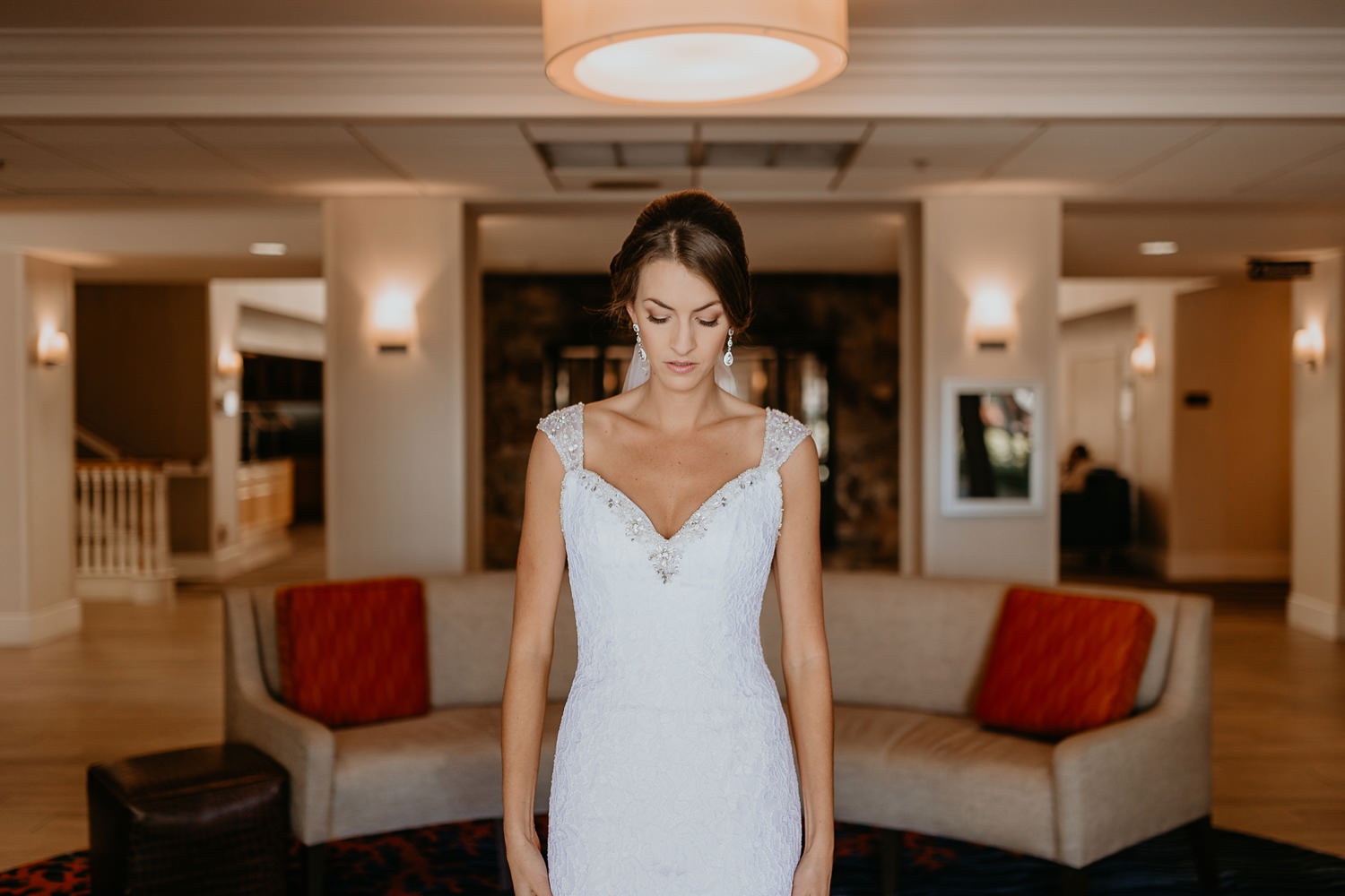 bride waist up looking down thinking in Lake Mary Hilton lobby