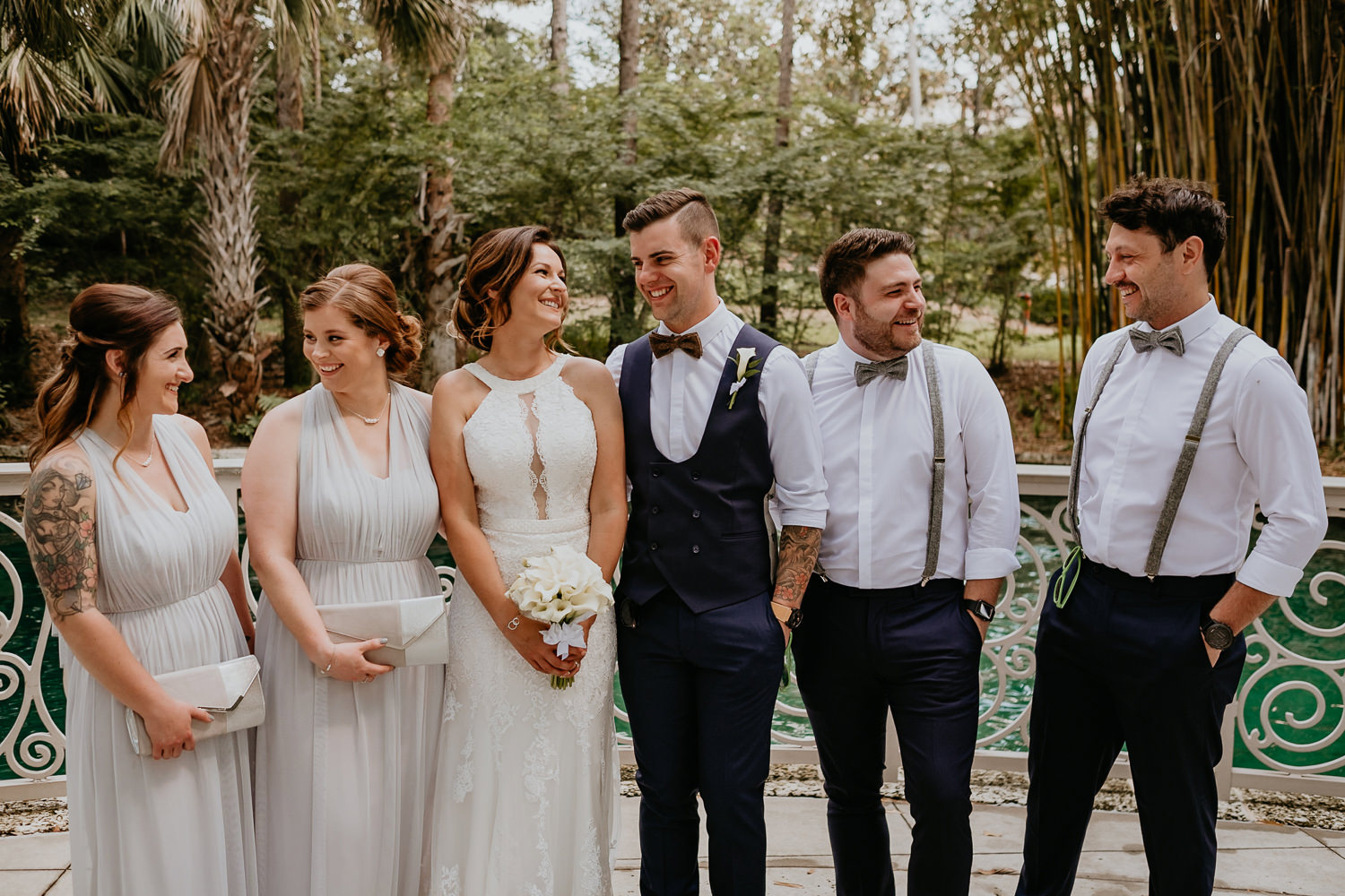 bridal party all posing laughing at each other