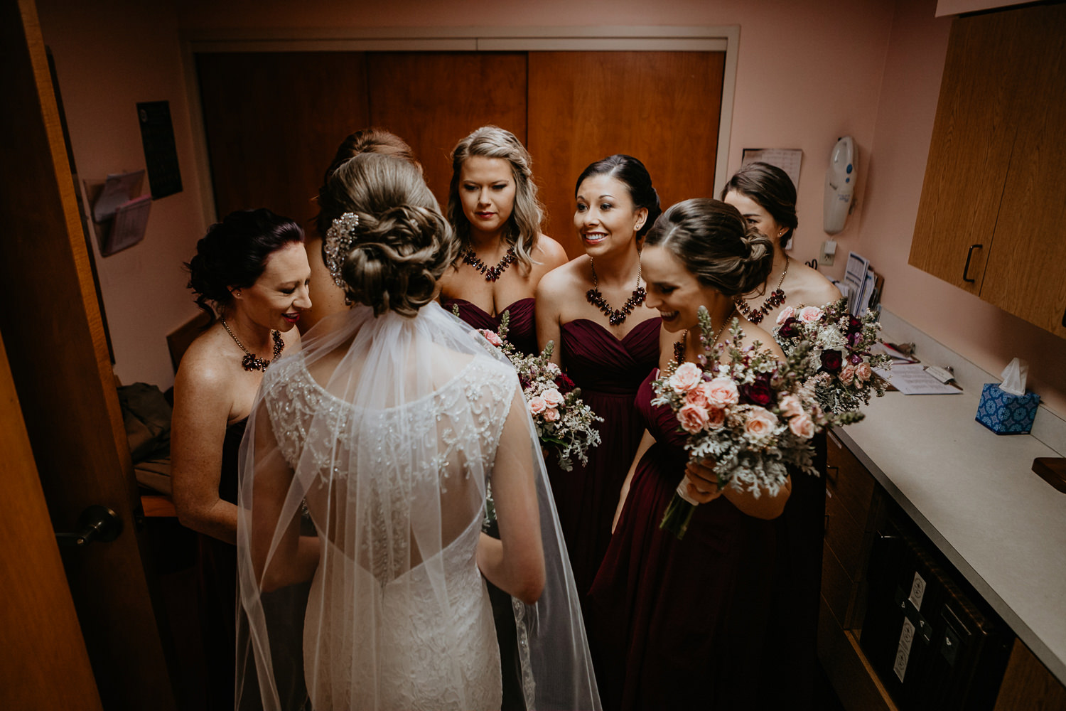 bride and bridesmaids still huddled after praying but all smiling