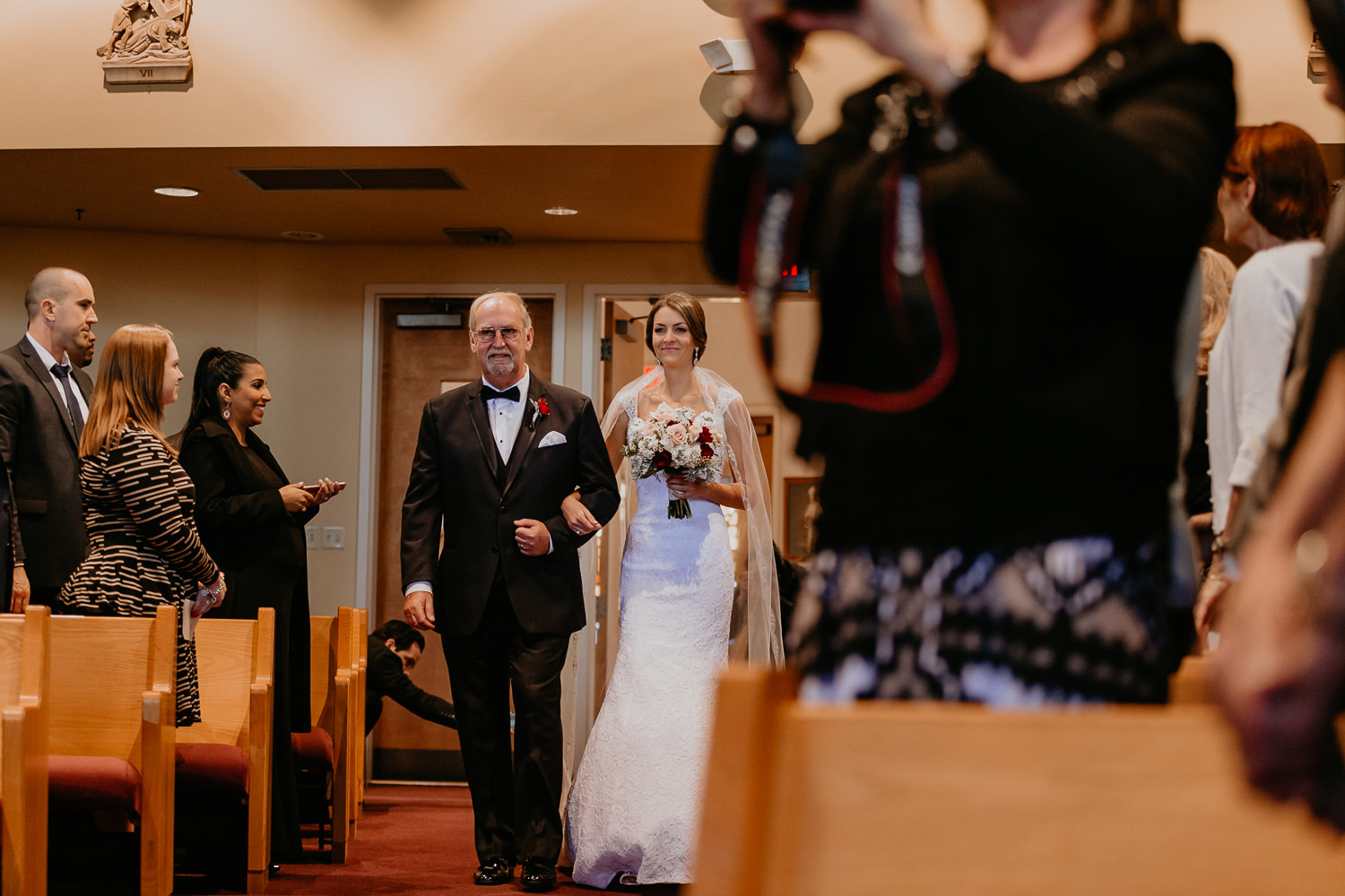 bride and father walking down church aisle