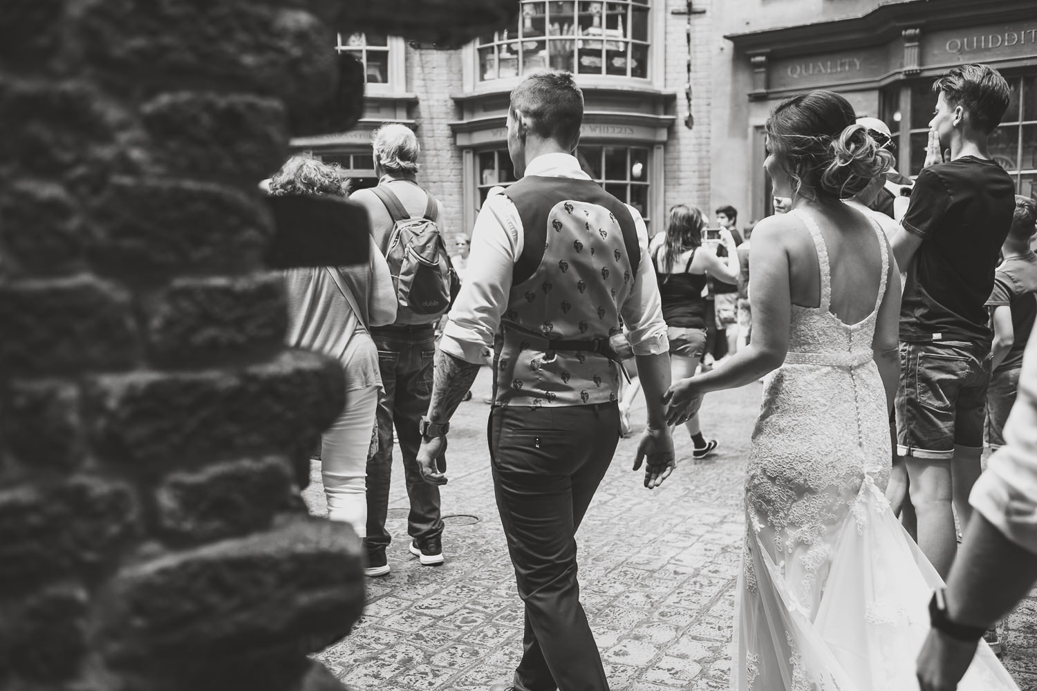 black and white newlyweds entering daigon alley